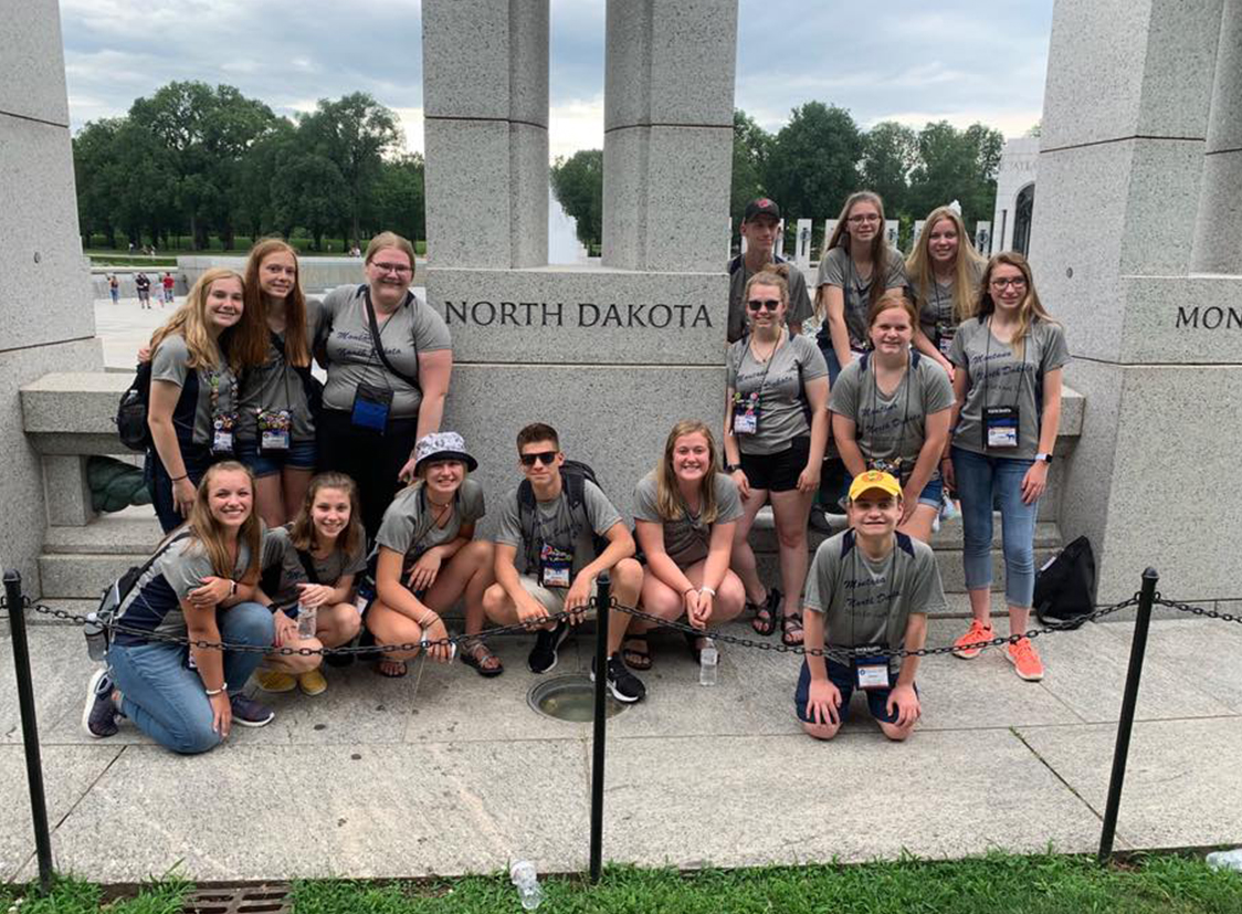 North Dakota youth tour students by North Dakota monument